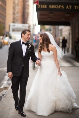 Bride in Vera Wang wedding dress and groom in tuxedo bow tie at The Plaza Hotel in New York City