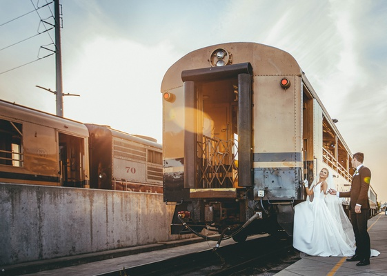 bride and groom boarding napa valley wine train for reception