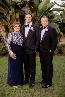 Gerrit Cole MLB pitcher with parents mother of groom in navy long sleeve gown corsage boutonnieres