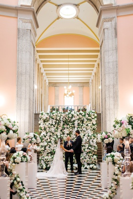 detroit lions tackle taylor decker wedding to bryn toyama in front of flower wall