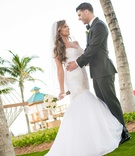bride in mermaid wedding dress maggie sottero with hair down curls groom in suit acqualina resort
