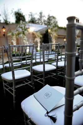 Ceremony booklet on alfresco chair cushion