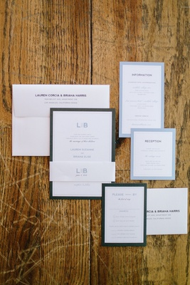 modern invitation suite with clean, crisp design, initials, blue border