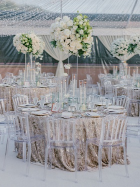 clear tent wedding reception cheryl burke matthew lawrence gold linens clear chairs white flowers
