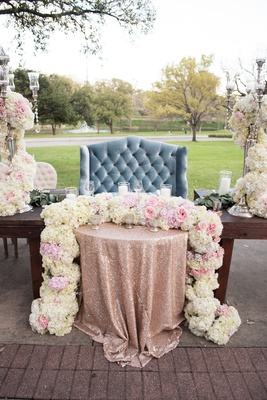 plush dusty blue love seat sweetheart table, rose gold sequin linen, floral runner