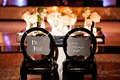 sweetheart table, bride and groom signs black chairs mirror table