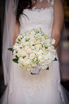 bridal bouquet of white roses hydrangeas and stephanotis