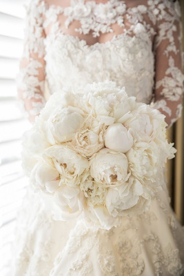 Bride in couture marchesa illusion wedding dress flower applique with bouquet white fluffy peony
