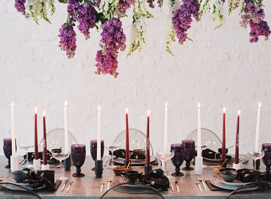 wedding reception event inspiration tablescape ghost chairs tall taper candles purple white goblets