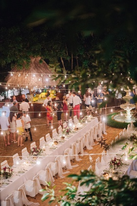 Wedding rehearsal dinner welcome party destination wedding evening night lights guests mexico