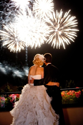 Bride and groom view firework display