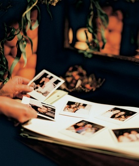 Wedding guest polaroid photos taped to guest book