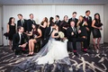 bride and groom with their bridesmaids and groomsmen in mostly black attire