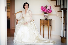 laura breckenridge wears vintage gown with long sleeves and collar