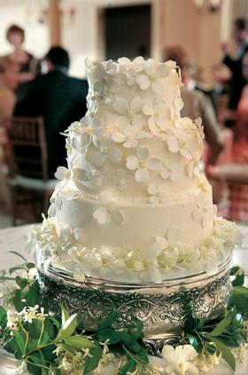 Three layer white cake on silver platter