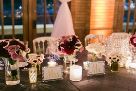 Head table with mr and mrs signs in crystal frames low flower centerpieces roses calla lilies purple
