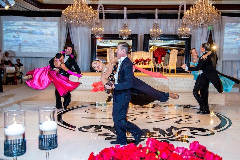 Ballroom dancers swinging on monogram dance floor
