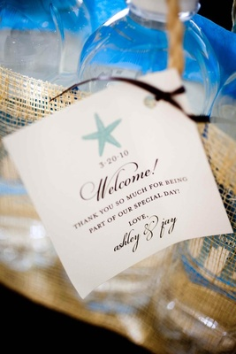 Wedding welcome stationery with blue starfish design