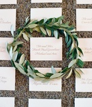 White seating card with champagne lettering