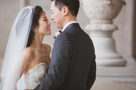 Korean bride in Kenneth Pool strapless wedding dress and groom on wedding day
