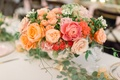 pink, orange, coral, blush roses in silver bowl for wedding centerpiece