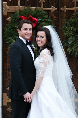 Bride in Oscar de la Renta wedding dress with groom in tuxedo and bow tie