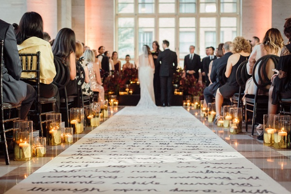 Wedding ceremony candles along custom aisle runner hand written poem letter candles guests