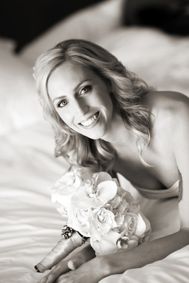 Black and white photo of bride with orchid and rose bouquet