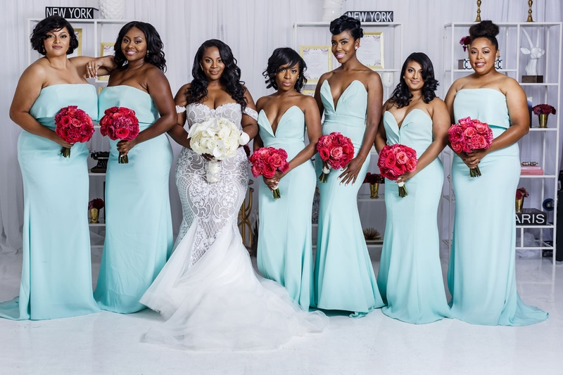 Bride in mermaid wedding dress white bouquet with bridesmaids mismatched mint blue green dresses