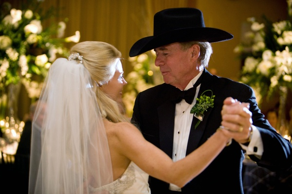 father of the bride wearing cowboy hat dancing with daughter