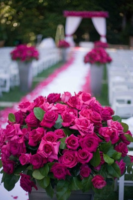 Ceremony aisle pink rose decorations for garden wedding