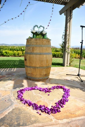 Purple flowers in heart shape at wedding ceremony altar
