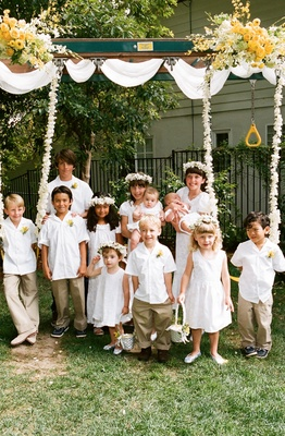 Twelve kids as wedding flower girls and ring bearers