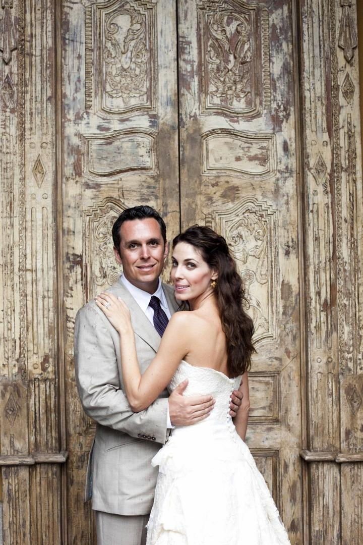 Newlyweds in front of large door in Costa Rica