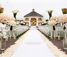 White monogram aisle runner with tons of roses