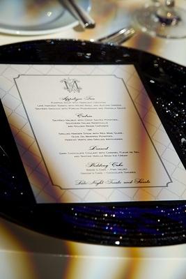Lattice patterned wedding menu card on glitter plate