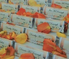 rows of place cards printed on citrus patterned paper