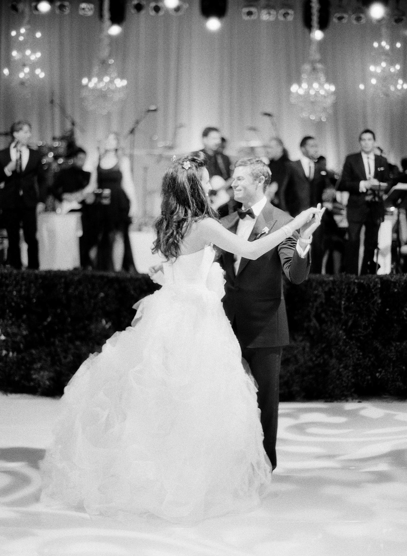 Black and white photo of first dance in front of band stage