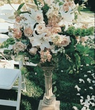 White ceremony chairs and aisleway flowers