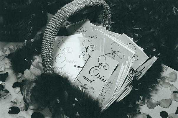 basket filled with wedding programs