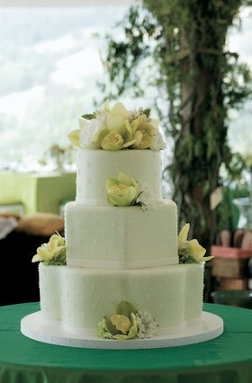 Green wedding cake with green and white flowers