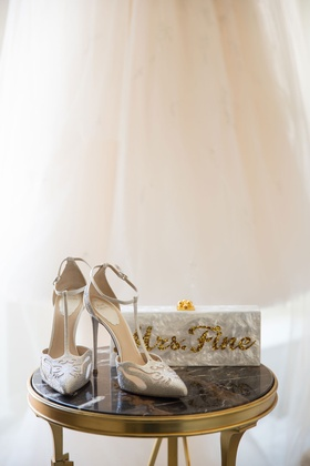 Rene Caovilla wedding shoe t strap pumps with mother of pearl box clutch with gold sequin lettering