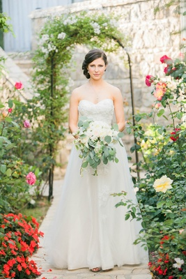 Bride in a winnie couture strapless A-line gown with a sweetheart neckline