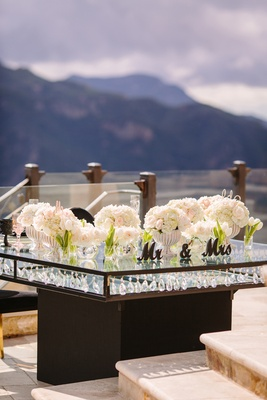 mirror top sweetheart table with crystal embellishments