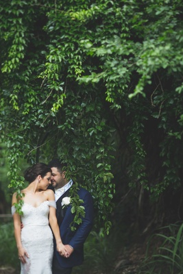 Maui Hawaii wedding bride in off the shoulder lace wedding dress groom navy tuxedo in rainforest