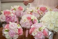 Bridesmaid bouquets of ivory and blush peony, rose flowers