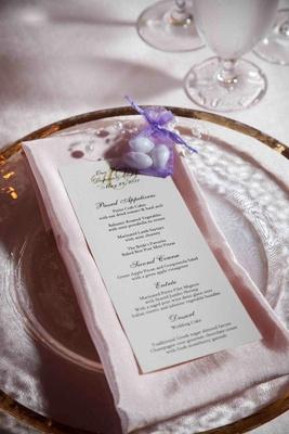 Almond wedding favors in purple organza bag