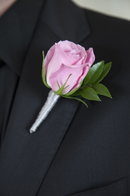Pink rose with leaves and silver ribbon boutonniere