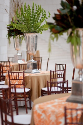 Reception tables with orange runners and Southern centerpieces