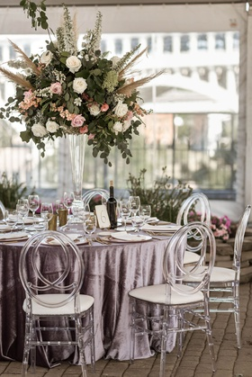 boho chic wedding reception clear tent velvet purple linen acrylic oval chair tall centerpiece